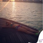 Elena Santarelli bikini tuta Flavia Padovan shorts Sundek scarpe Nike