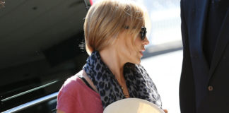 Kylie Minogue borsa Roberto Cavalli Regina sneakers Chanel stola Louis Vuitton cappello Maison Michel
