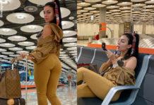 Georgina Rodriguez in aeroporto con leborse Louis Vuitton, outfit Alo Yoga e sneakers Nike